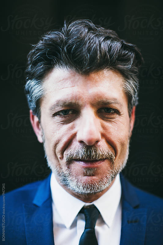 Closeup portrait of a mature businessman. by BONNINSTUDIO for Stocksy United
