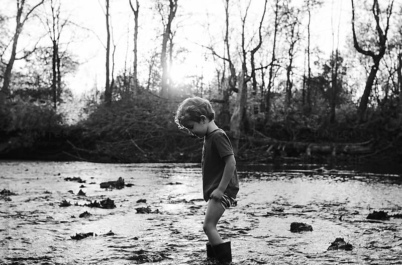 Young Boy in a Creek by Ali Deck for Stocksy United