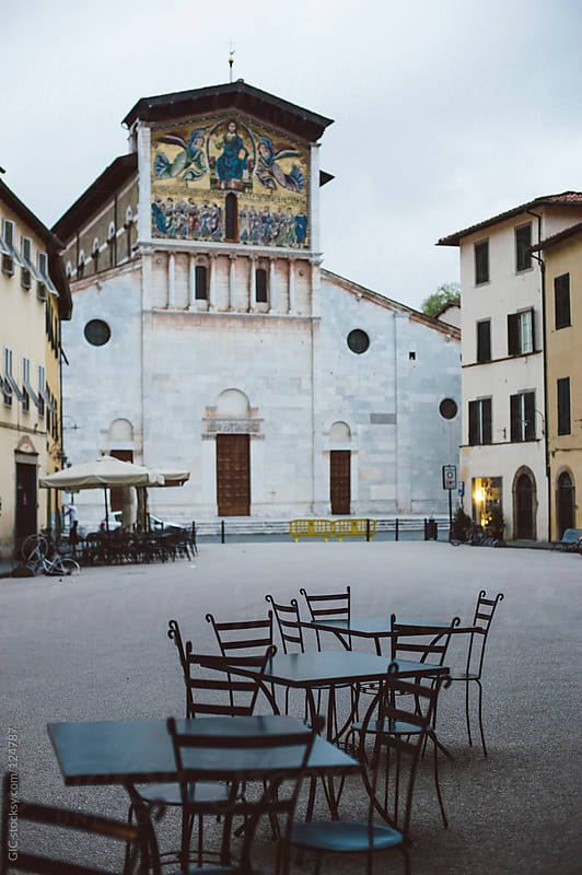 Traditional square with Church in Lucca, Tuscany by GIC for Stocksy United