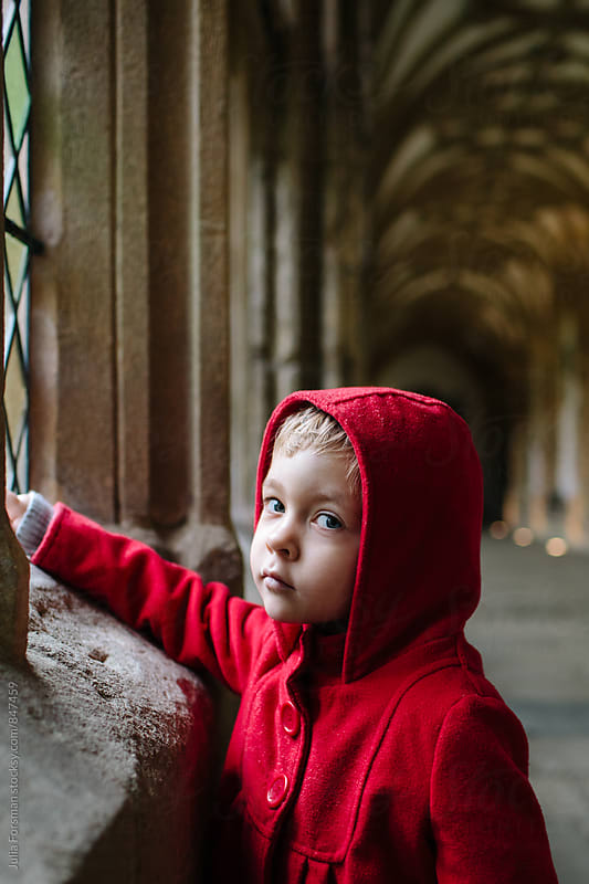 Thoughtful girl looking to camera in a medieval cloister. by Julia Forsman for Stocksy United