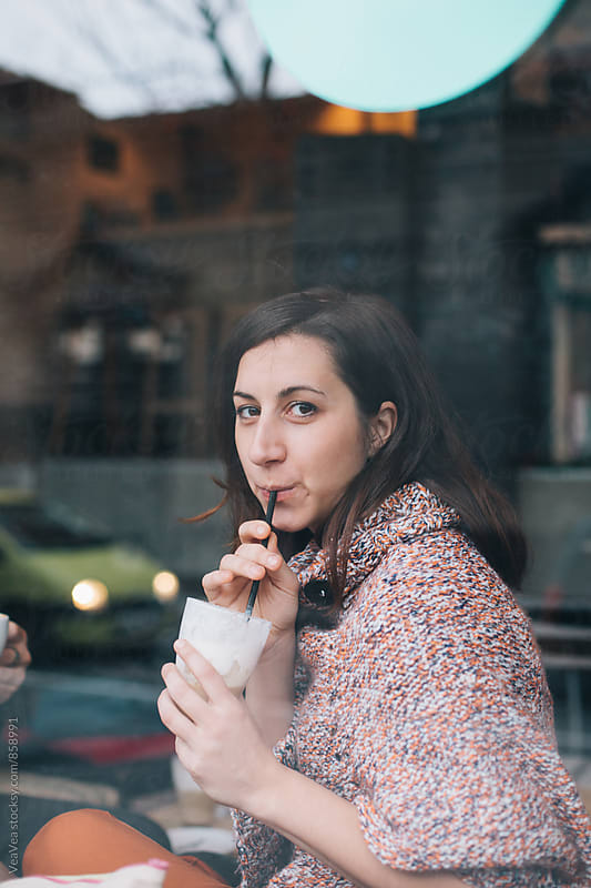 Beautiful woman drinking cafe latte in a cafe  by Marija Mandic for Stocksy United