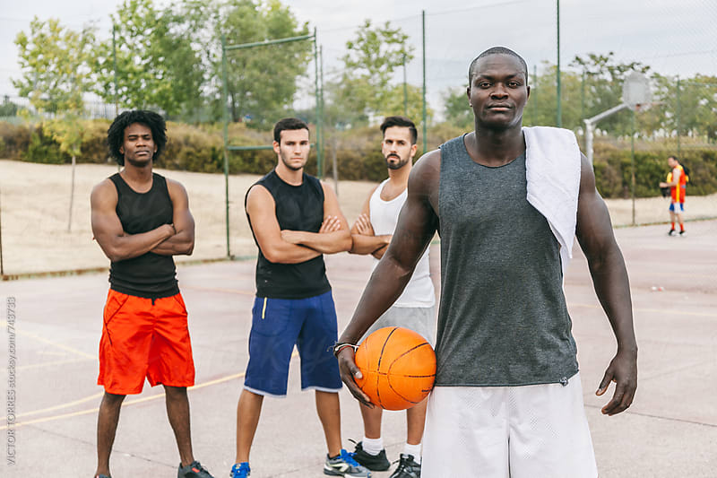 Friends Rests After a Street Basketball Game by VICTOR TORRES for Stocksy United