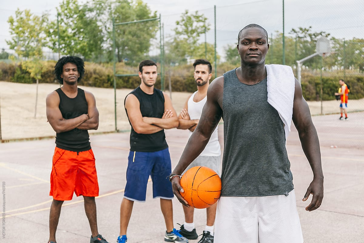 Friends Rests After A Street Basketball Game By Victor Torres Stocksy United