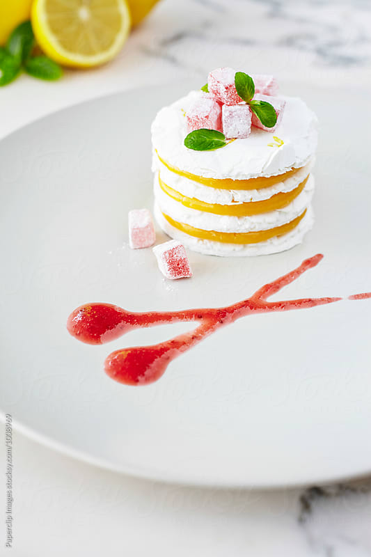 Lemon meringue with mint and strawberry marmalade by Paperclip Images for Stocksy United