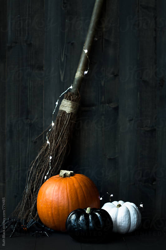 Halloween pumpkins and broomstick by Ruth Black for Stocksy United