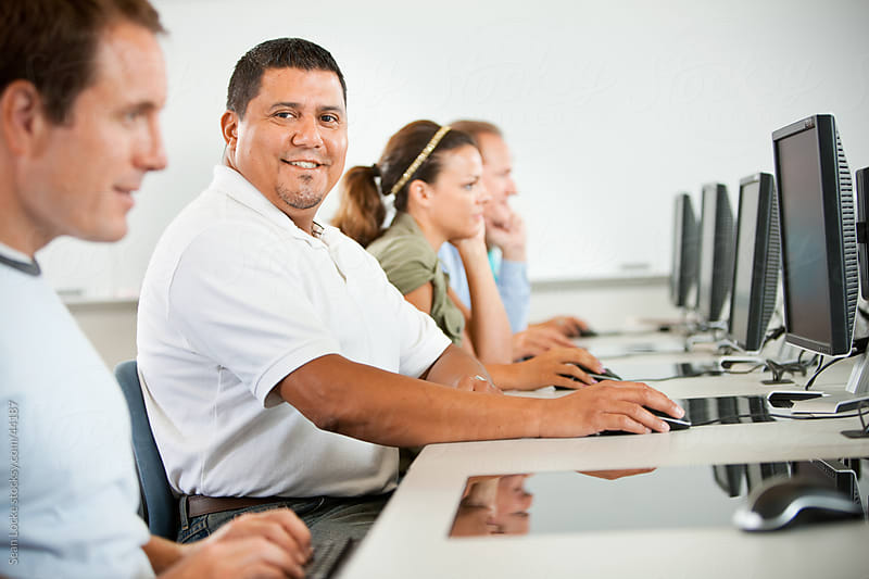 Computer Class: Hispanic Male Taking Computer Class by Sean Locke for Stocksy United