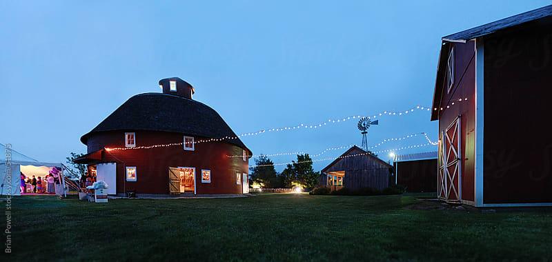 farm wedding reception at twilight by Brian Powell for Stocksy United