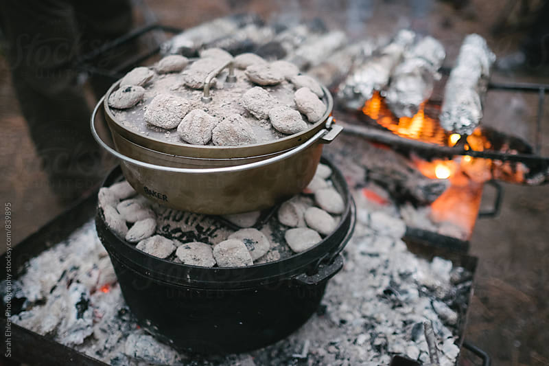 Campfire cooking in dutch ovens by Sarah Ehlen Photography for Stocksy United