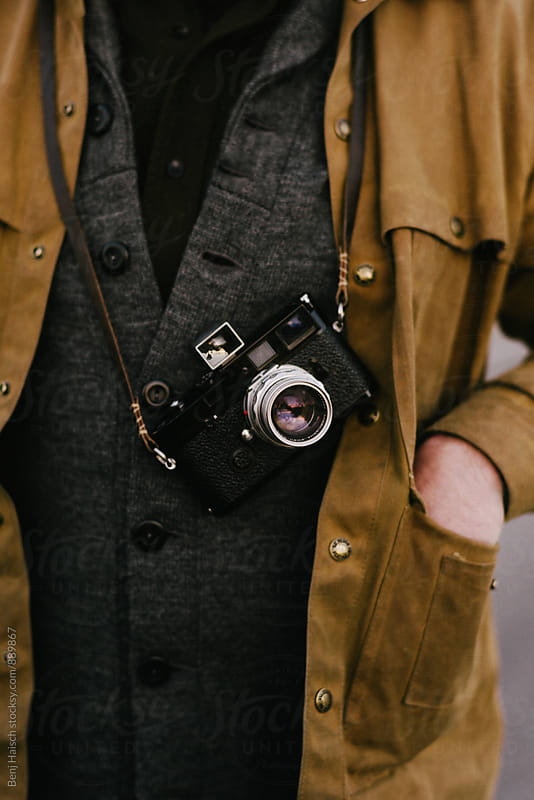 Man with a Vintage Camera Around His Neck by Benj Haisch for Stocksy United