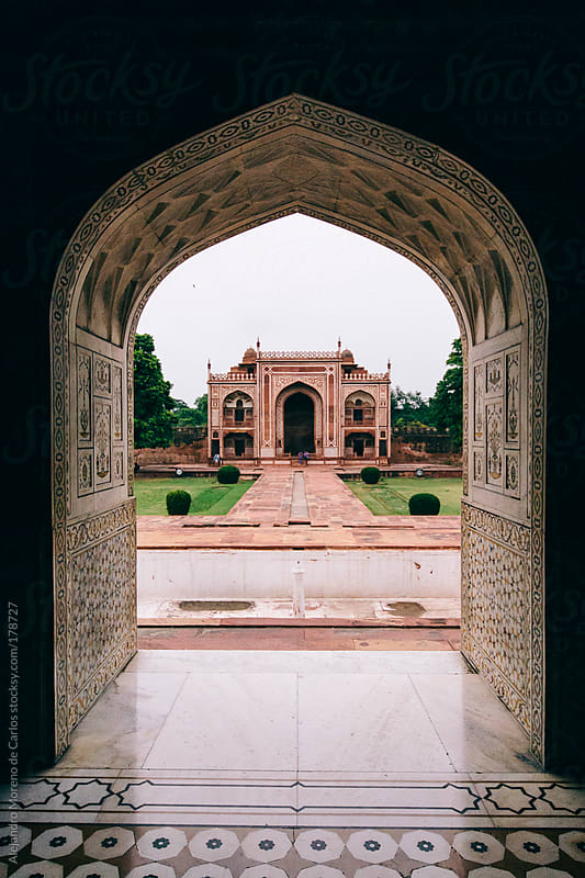 Arch and orange mughal construction on Baby Taj palace - mausoleum, Agra, India by Alejandro Moreno de Carlos for Stocksy United