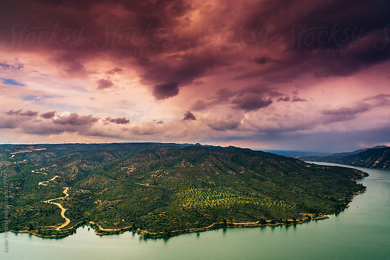 clouds above lake at sunset by Javier Pardina for Stocksy United