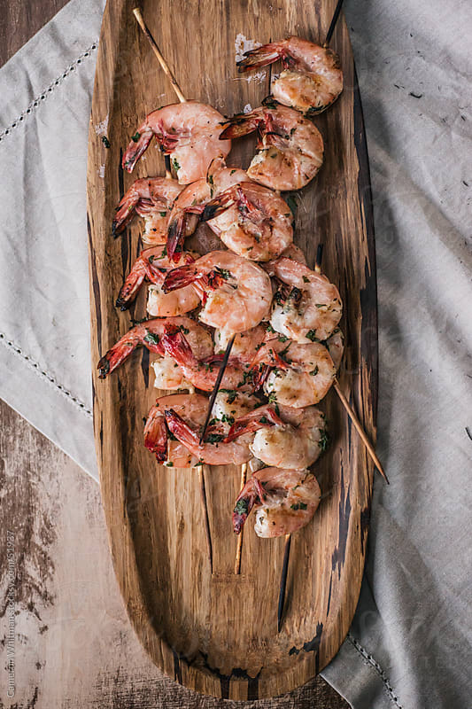 Grilled Shrimp Skewers  by Cameron Whitman for Stocksy United