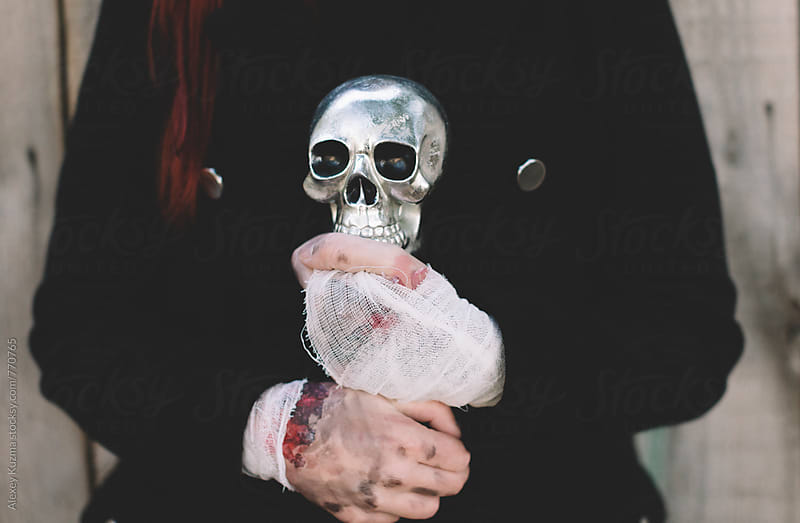 skull on the hands  by Alexey Kuzma for Stocksy United