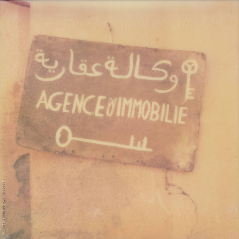 Old Pink Painted Sign in Arabic with Key Illustrations by Briana Morrison for Stocksy United