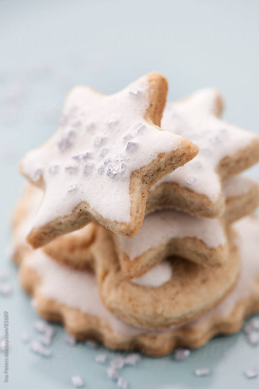 Food: stacked christmas cookies with icing by Ina Peters for Stocksy United