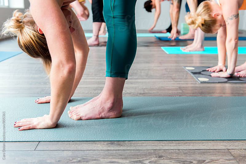 Yoga class in a modern studio by Cara Slifka for Stocksy United