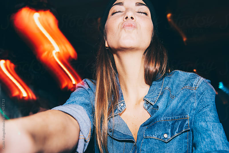 Beautiful woman doing a selfie in a pub by Guille Faingold for Stocksy United