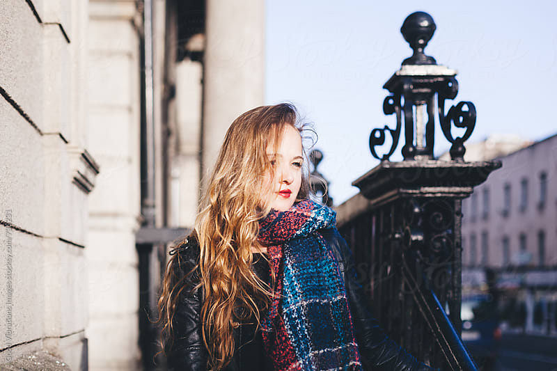 Woman portrait in the city in winter by Good Vibrations Images for Stocksy United