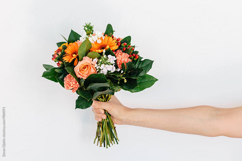 Woman's hand holding a bouquet of flowers. by Zocky for Stocksy United