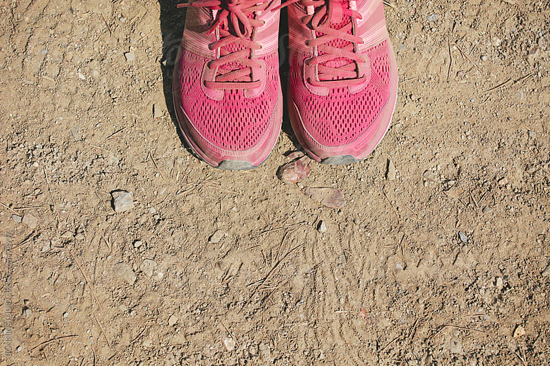Overhead view of a pink trail shoes on grit background. by BONNINSTUDIO for Stocksy United
