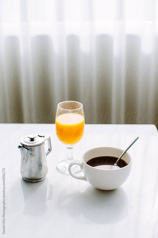 Coffee and orange juice by Daniel Kim Photography for Stocksy United
