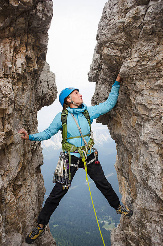 Female alpinist climbing a rock chimney in Dolomites by RG&B Images for Stocksy United
