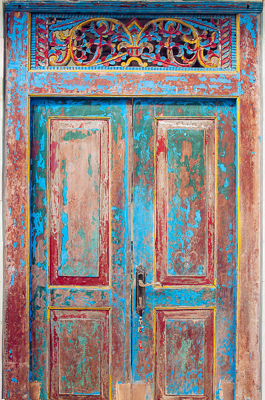 The Antique Painted Front Door by Alexander Grabchilev for Stocksy United