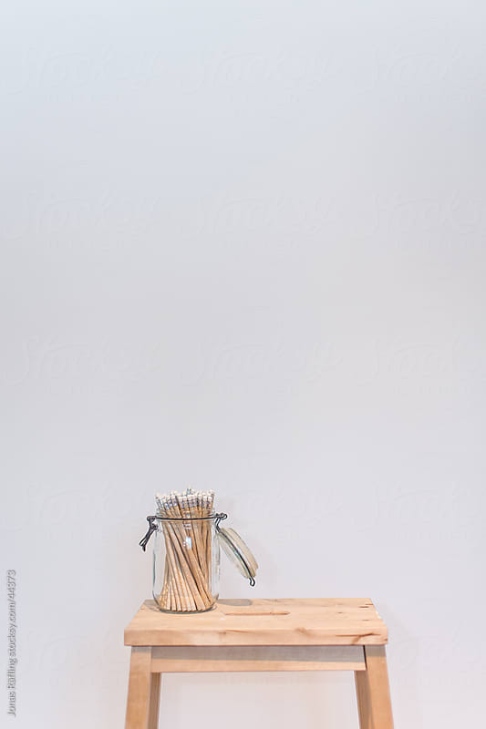 Pencils in a jar on a pallet by Jonas Räfling for Stocksy United