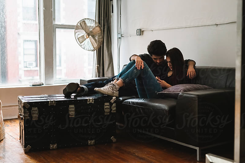 Young couple relaxing at home by GIC for Stocksy United