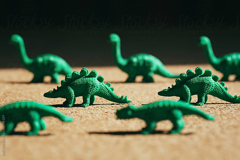 Closeup Image of Green Toy Dinosaurs Lined Up by Kelli Seeger Kim for Stocksy United