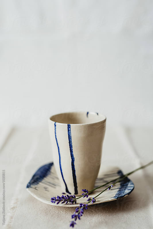 Artistic mug and plate with lavender by Tatjana Ristanic for Stocksy United