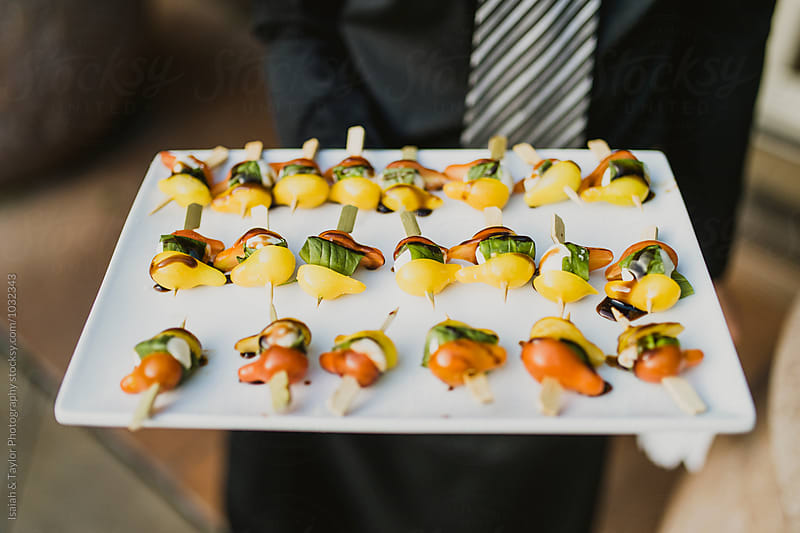 Appetizers being served by Isaiah & Taylor Photography for Stocksy United