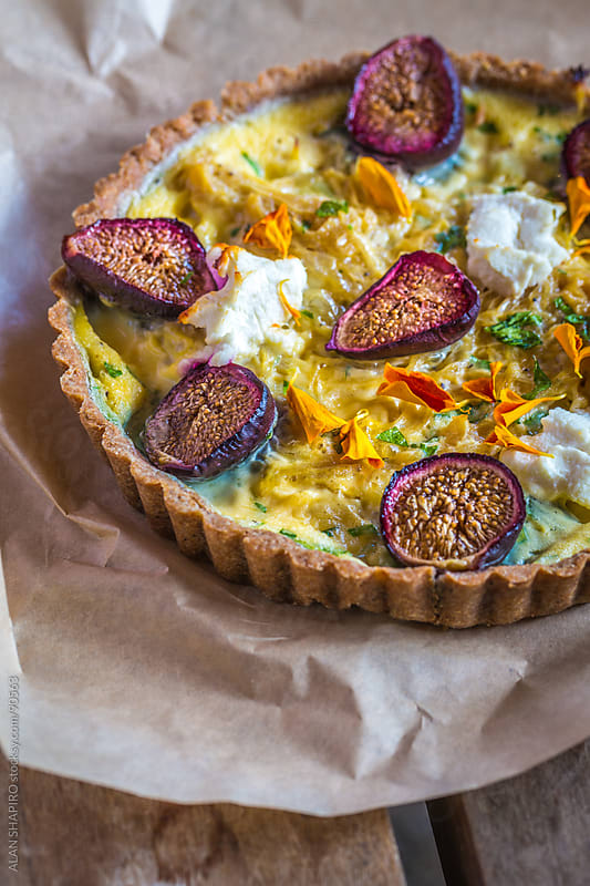 Tart with figs, gruyere, onions, goat cheese and nasturtiums by alan shapiro for Stocksy United