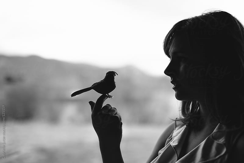 Beautiful Woman Holding a Fake Bird - Black and White by Gabrielle Lutze for Stocksy United