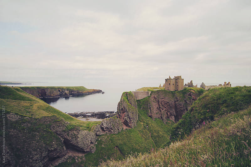 Ruined castle Dunnotar and its colorful Northern Scottish seaside landscape by Kaat Zoetekouw for Stocksy United