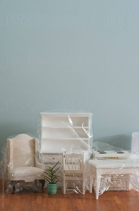 Furnitures wrapped, ready to move by Alita Ong for Stocksy United