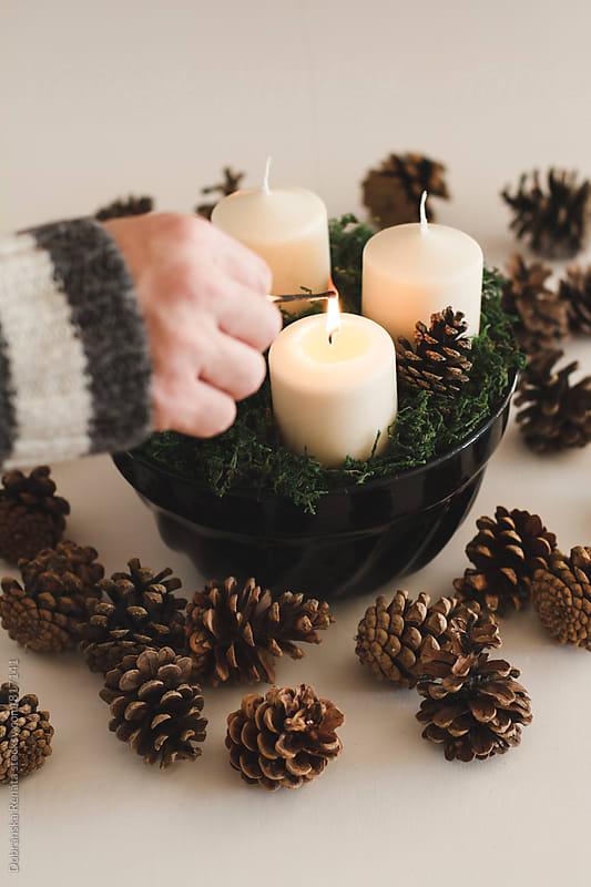 Lighting a Christmas candles by Dobránska Renáta for Stocksy United