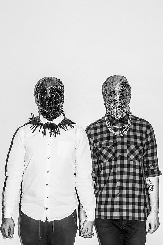 faceless fashionable couple,tattoo,style,love,direct light by Igor Madjinca for Stocksy United