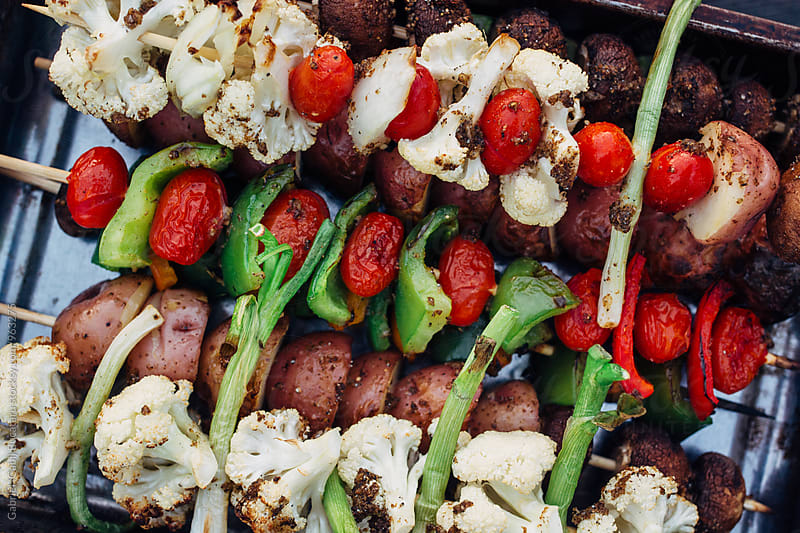 Various grilled vegetables on skewers by Gabriel (Gabi) Bucataru for Stocksy United