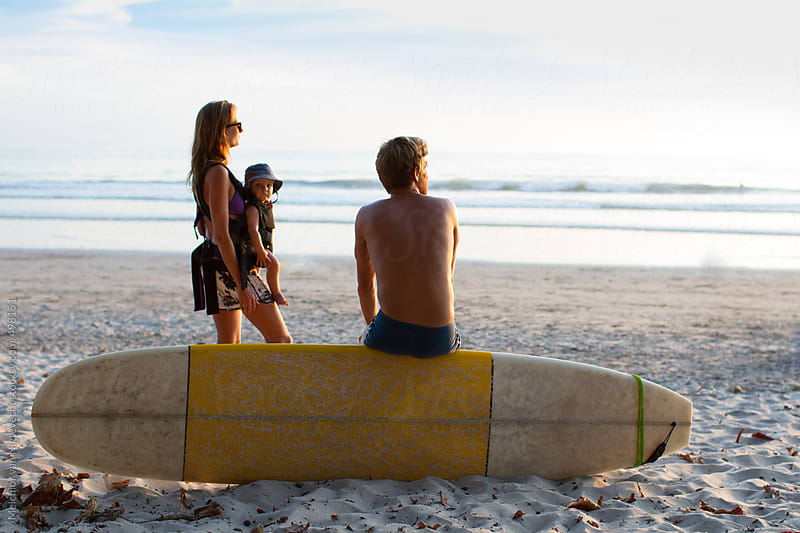 Family watching the waves by Melchior van Nigtevecht for Stocksy United