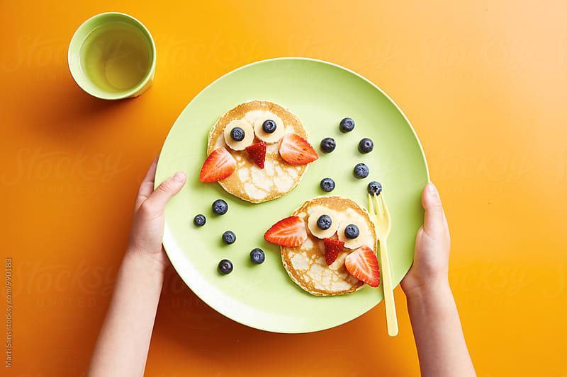Creative breakfast with pancake owls by Martí Sans for Stocksy United