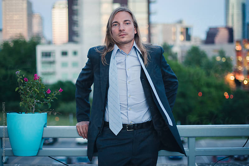 Young Businessman Relaxing on Rooftop by Geoffrey Hammond for Stocksy United