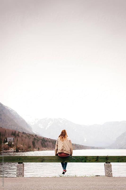 Girl sitting at a lake enjoying the amazing view. by Koen Meershoek for Stocksy United