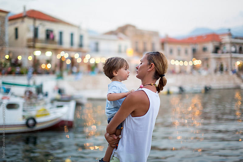 Mother with her kid outdoor by Nasos Zovoilis for Stocksy United
