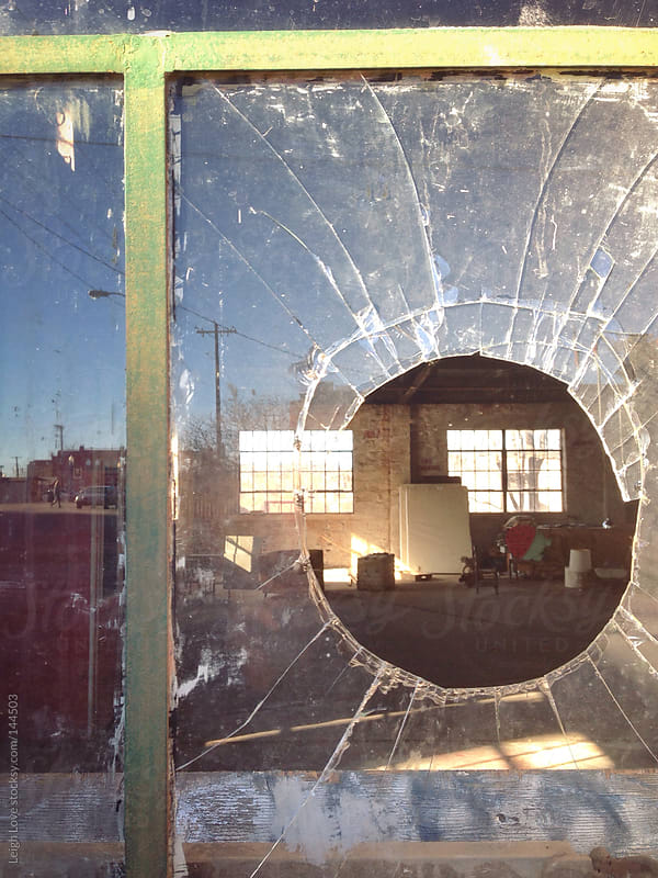 View Inside An Abandoned Building Through Broken Glass by Leigh Love for Stocksy United