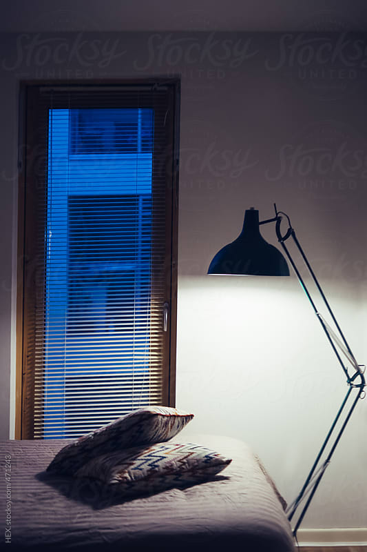 Cozy Bedroom With Giant Task Lamp and Cousins by HEX. for Stocksy United