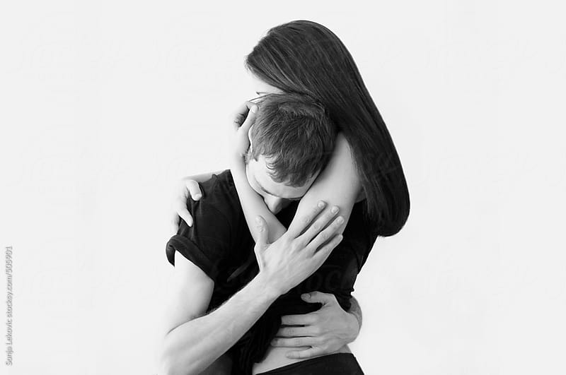 romantic couple hugging in black and white by Sonja Lekovic for Stocksy United