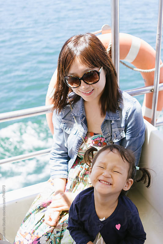 Mother and daughter on a boat by Maa Hoo for Stocksy United