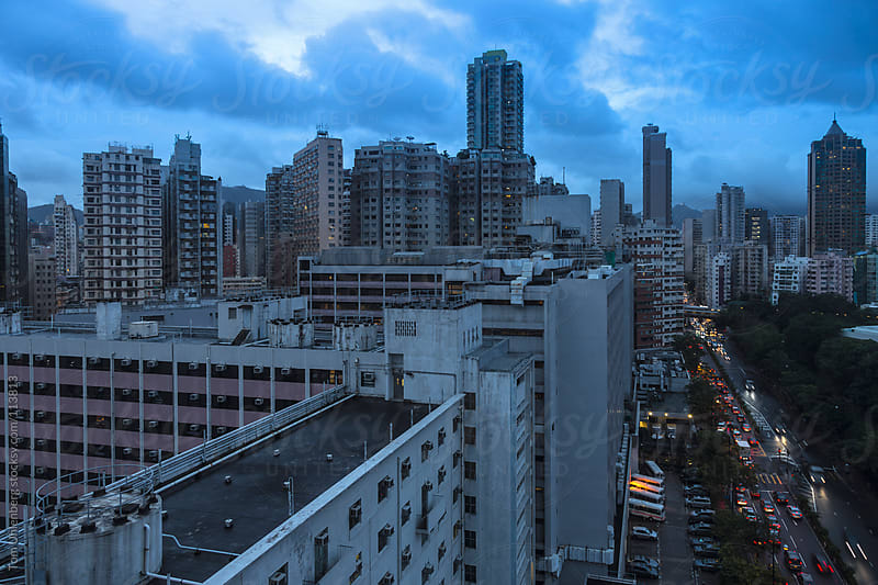Hong Kong Cityscape at Dusk - Taken in Yau Ma Tei, Kowloon by Tom Uhlenberg for Stocksy United