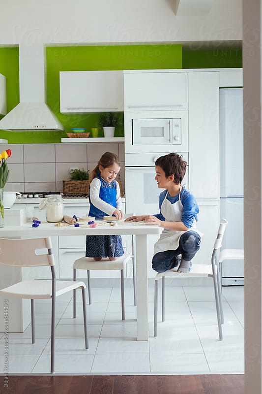 Children playing with dough. by Dejan Ristovski for Stocksy United